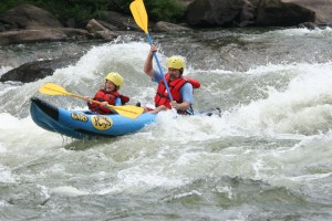 Man and boy rafting